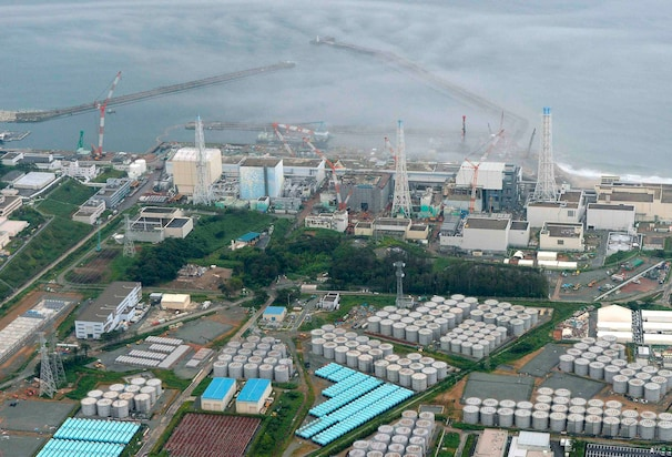 An aerial view shows Tokyo Electric Power Co. (TEPCO)'s crippled Fukushima Daiichi nuclear power plant and its contaminated water storage tanks. The operator of the nuclear plant said that four tonnes of rainwater that may be contaminated leaked during a transfer of radioactive water between tank holding areas.