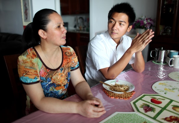 Daniel Chen chats with his mother. About one out of every five residents of this country speaks a language other than English at  home.