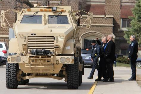 Police officers in Mason City, Iowa, get a look on April 14 at the department's new mine-resistant ambush-protected vehicle on loan from the Department of Defense. The vehicle will be used primarily by North Central Iowa Special Operation Groups. (Arian Schuessler/The Globe Gazette via Associated Press)
