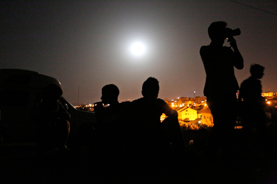 https://i2.wp.com/img.washingtonpost.com/rf/image_908w/2010-2019/WashingtonPost/2014/07/13/Health-Environment-Science/Images/Mideast_Israel_Palestinians_Supermoon-05080.jpg