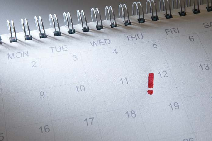 calendar with exclamation mark on date