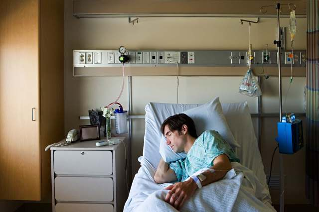 man in hospital bed