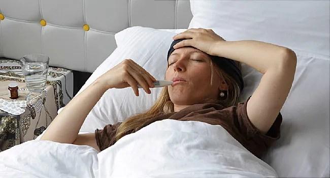 girl taking temperature