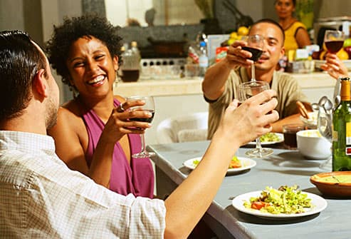 friends enjoying wine with dinner