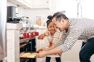 photo of father and daughter baking