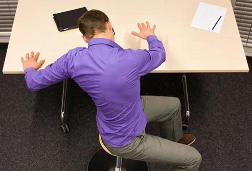 man doing exercise at desk