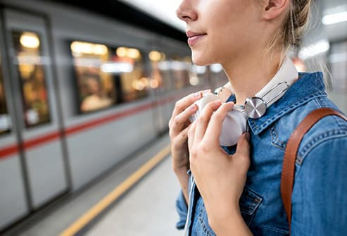 woman waiting for commuter train