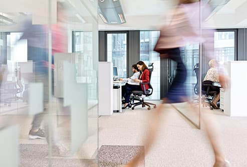 woman walking through office