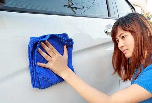 young woman polishing car