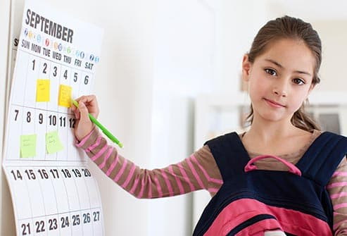 getty_rf_photo_of_girl_with_calendar