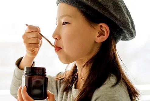 Girl eating honey