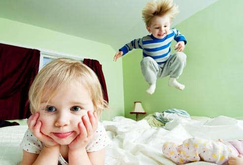getty_rf_photo_of_kids_jumping_on_bed