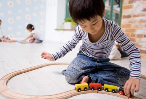 getty_rm_photo_of_child_playing_with_train