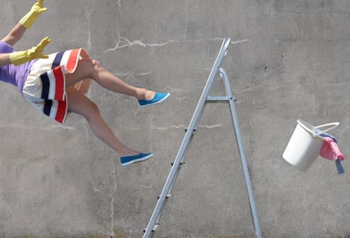 Woman Falling off of a Ladder