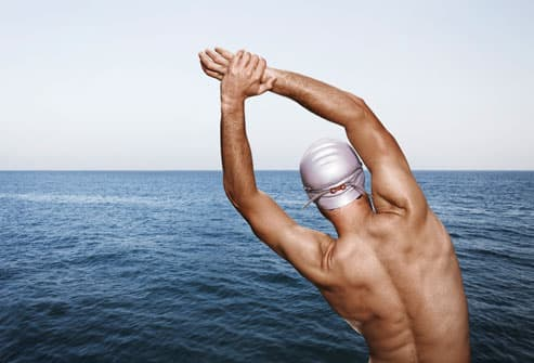 Male Swimmer Stretching