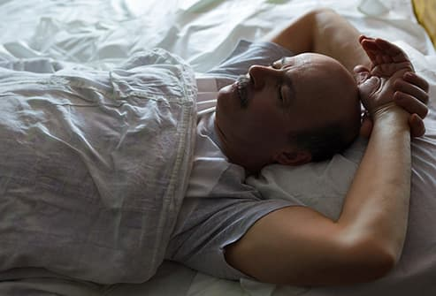 man sleeping on back