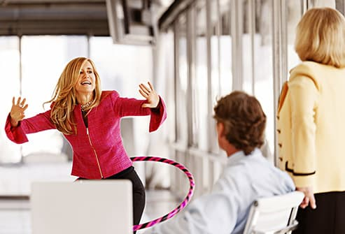 office worker using hula hoop