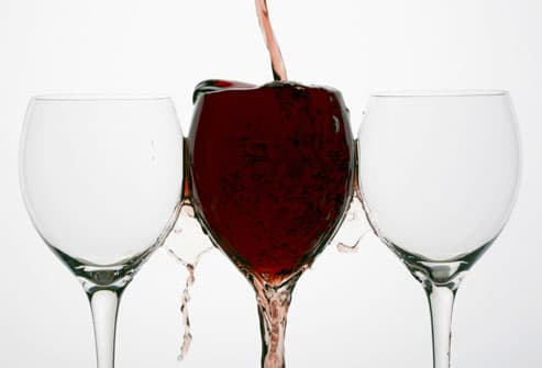 Red Wine Spilling Out of Glass