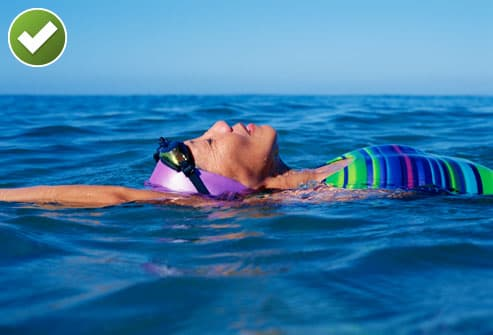 Older Woman Swimming in the Ocean