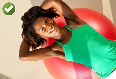Smiling Woman In Pilates Class