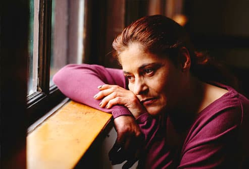 Woman Looking out of a Window