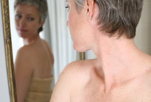Woman Gazing in Mirror