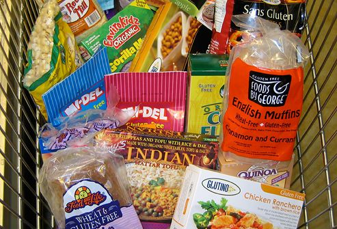 Variety of gluten-free products in grocery basket