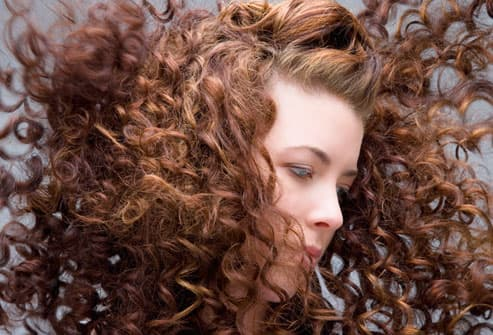 Young woman with hair blowing in wind