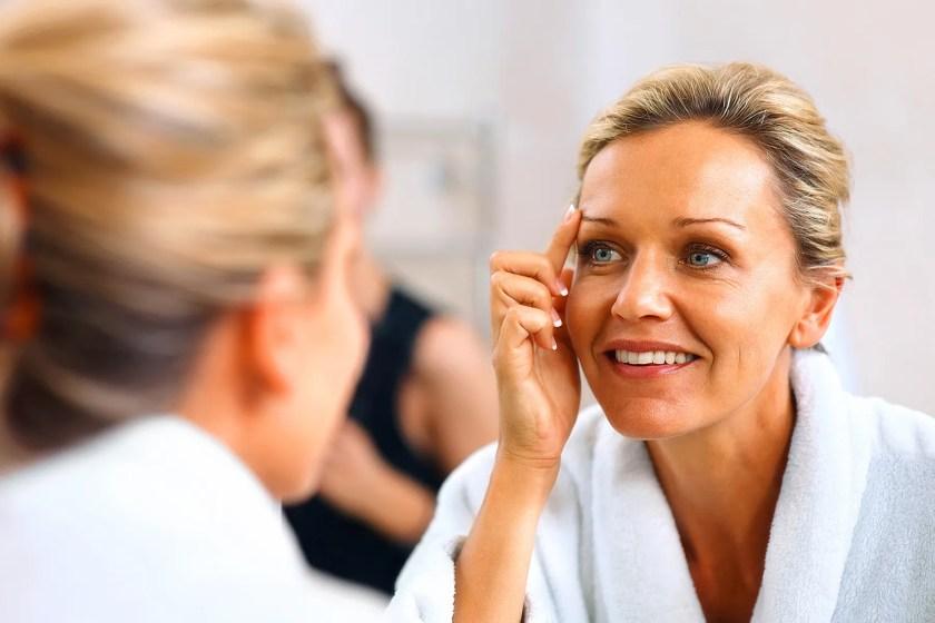 woman rubbing eyebrow