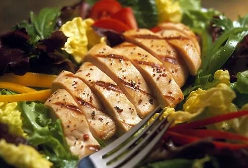 Sliced chicken breast on salad