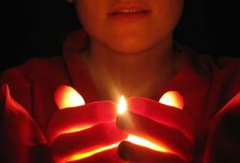 woman holding candle