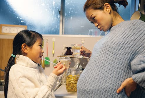 mother making drink with daughter