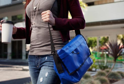 woman with heavy tote bag