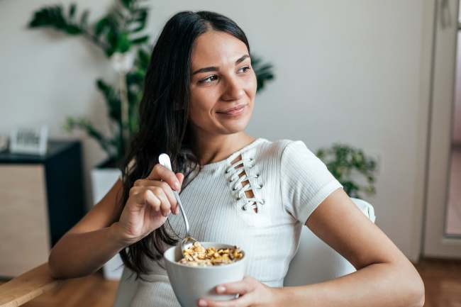 photo of woman eating breakfast