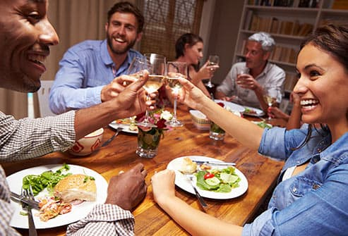 group of friends at dinner party