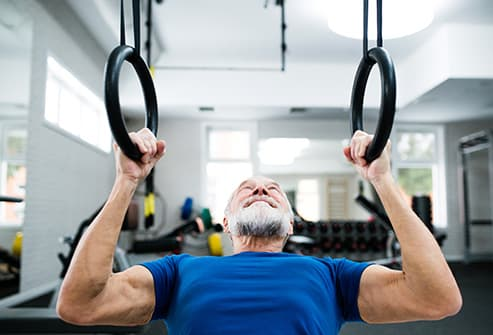 senior man working out in gym