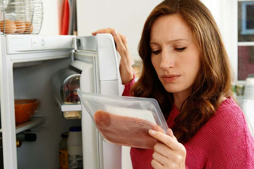 woman looking at lunch meat