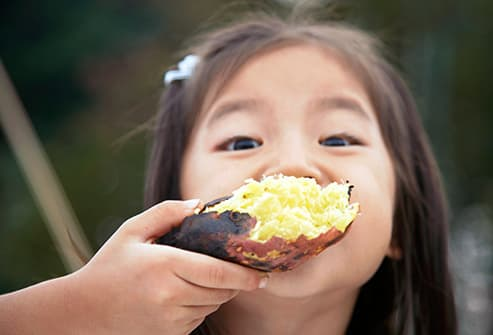 girl eating sweet potato
