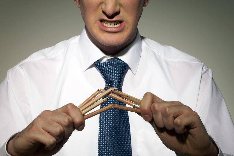 close-up of businessman breaking pencils
