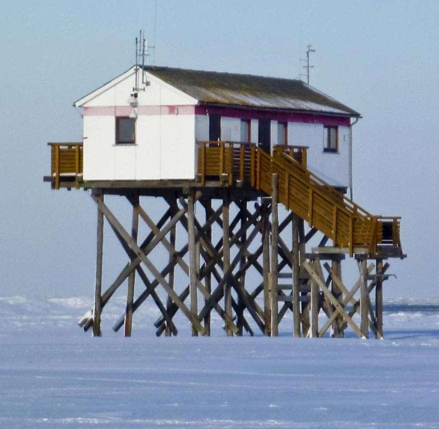 North Sea in winter: a stilt hut in Sankt Peter-Ording