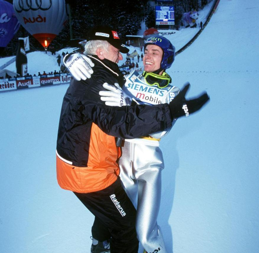 January 6, 2002: Trainer Reinhard Hess hugs Sven Hannawald when the tour victory is perfect