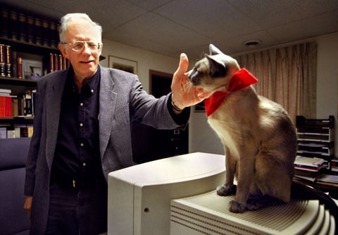 William Pierce, founder of the (White Power group) National Alliance, is the new owner of Resistance Records. In his office, Pierce pets his 8-year-old Blue Point Siamese cat named Hadley. Photographed January 4, 2000 in Hillsboro, WV.