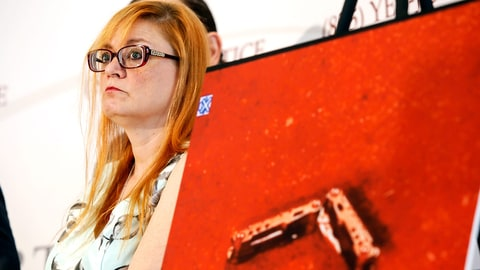 Lynne Schultz, mother of Scout Schultz, stands beside an enlarged photograph of a multipurpose tool at a news conference in Atlanta, Ga., Monday, Sept. 18, 2017. Scout was a 21-year-old Georgia Tech student who was shot and killed while holding the tool during a confrontation with police on campus Saturday, Sept. 16. (Casey Sykes/Atlanta Journal-Constitution via AP)