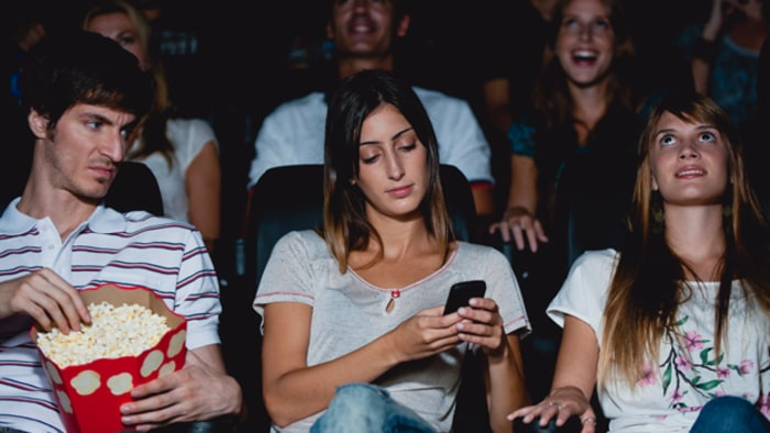 Image result for texting in the movies