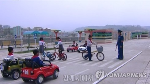 This still image, captured from video footage from North Korea's Korean Central TV on May 14, shows children taking part in traffic safety education at a traffic park in the city of Kanggye in North Korea's northern Jagang Province. (For Use Only in the Republic of Korea. No Redistribution) (Yonhap)