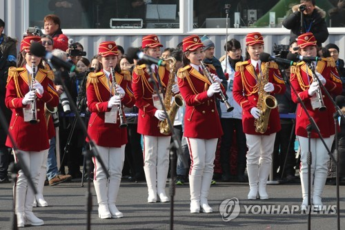 An all-female North Korean marching band performs at a welcome event for the North's Olympic squad at the Gangneung Olympic Village in Gangneung, a venue for the PyeongChang Winter Olympics, on Feb. 8, 2018. (Yonhap)