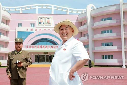 Kim Jong-un visits nursery, orphanage