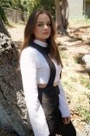 Joey King Photoshoot In White Top Black Pants 2