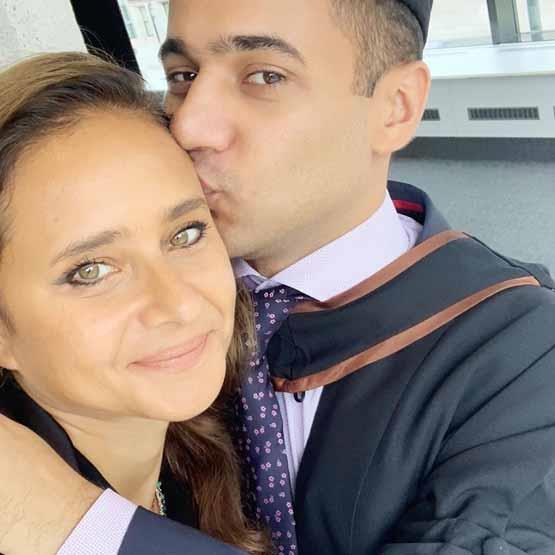 Yusef kisses his mother's head