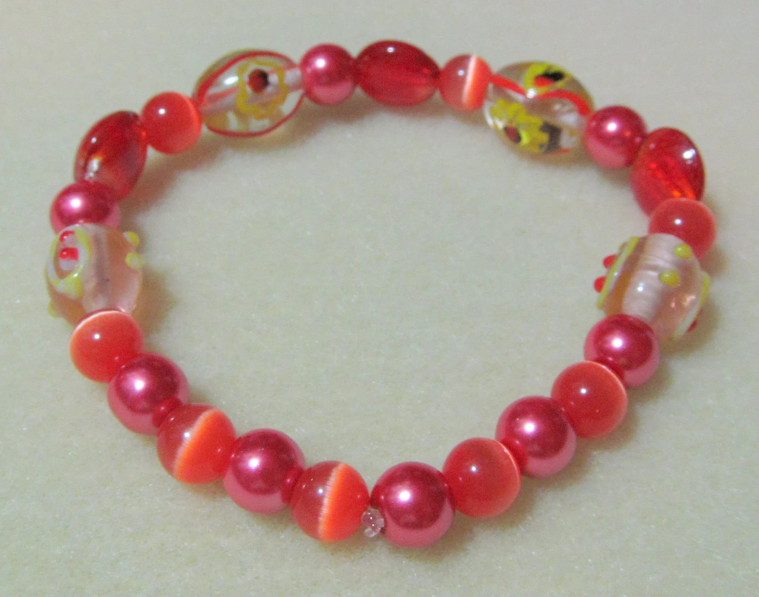 Bracelet -fun stretch magic red orange yellow glass pearl cat eye lampwork beads